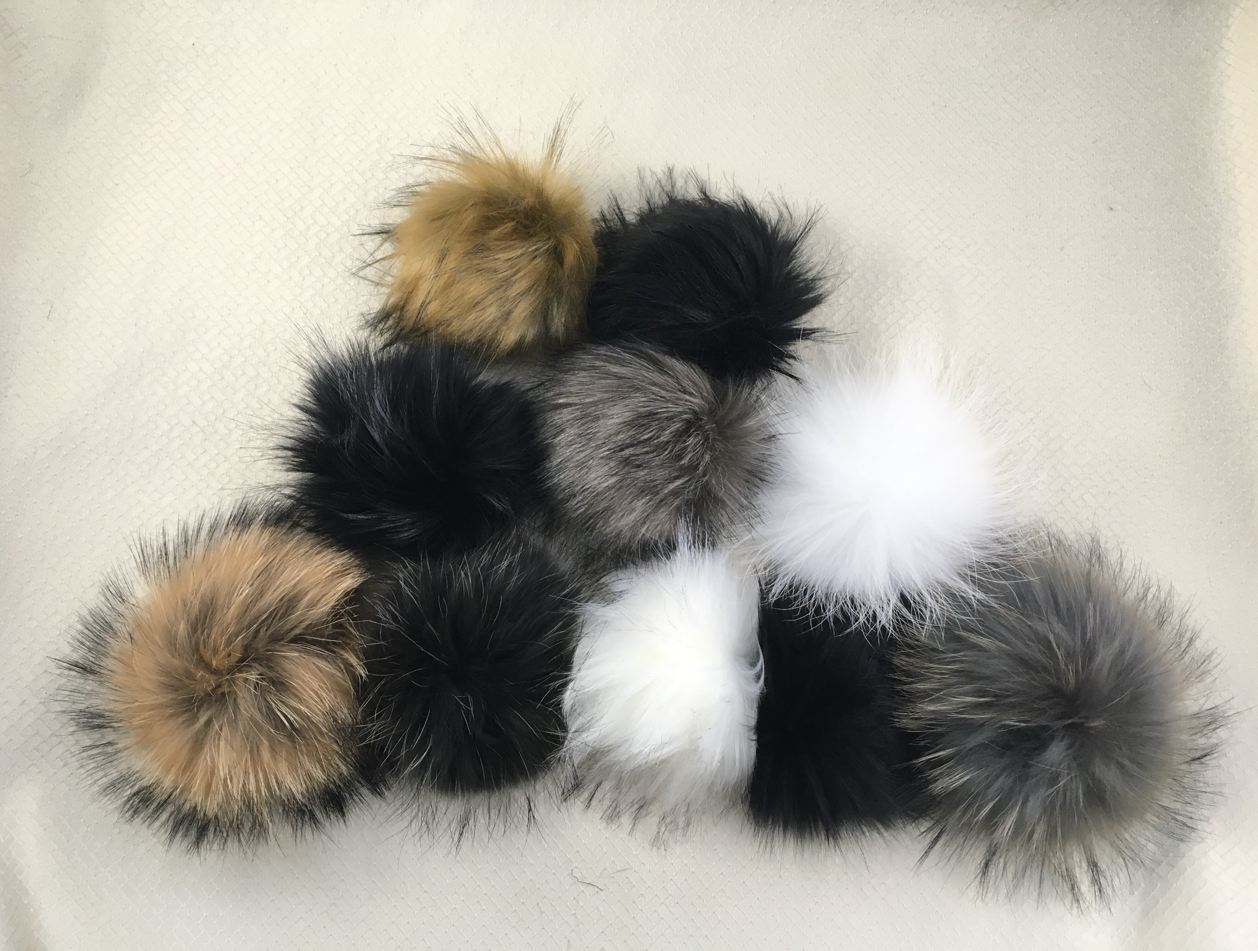 Real and Faux Fur Pom Poms - Perfect for all your winter projects.